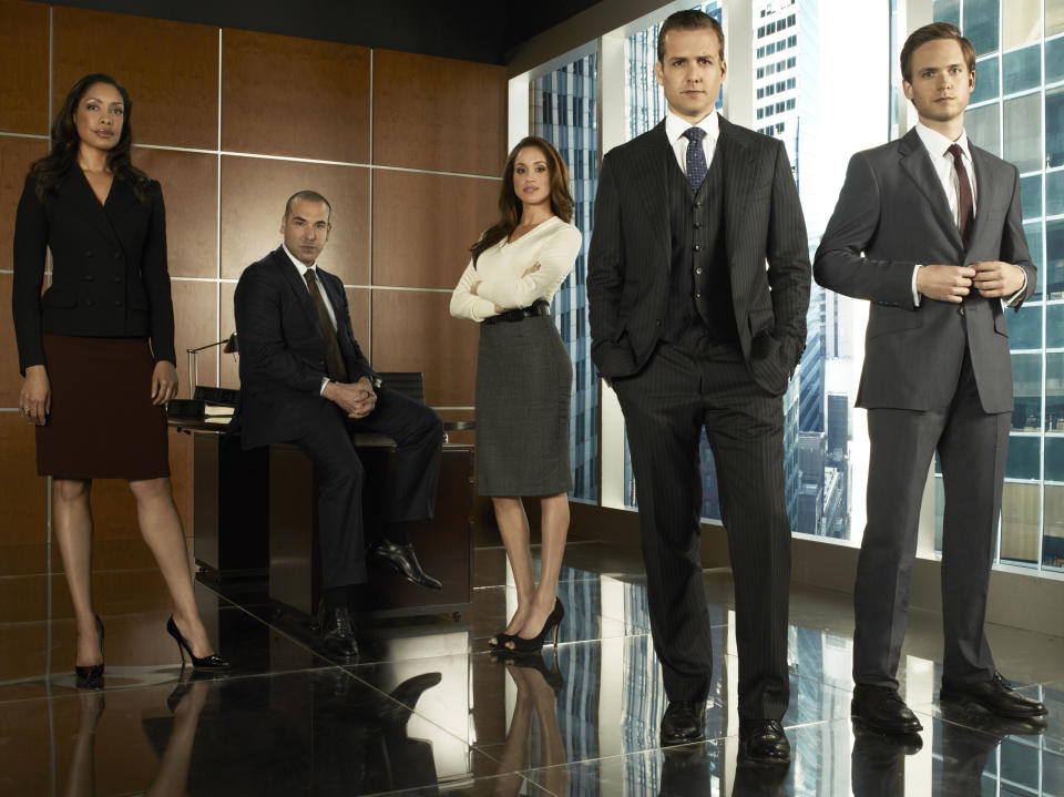 SUITS -- Season 1 -- Pictured: (l-r) Gina Torres as Jessica Pearson, Rick Hoffmann as Louis Litt, Meghan Markle as Rachel Zane, Gabriel Macht as Harvey Specter, Patrick Adams as Mike Ross -- (Photo by: Frank Ockenfels/USA/NBCU Photo Bank/NBCUniversal via Getty Images)