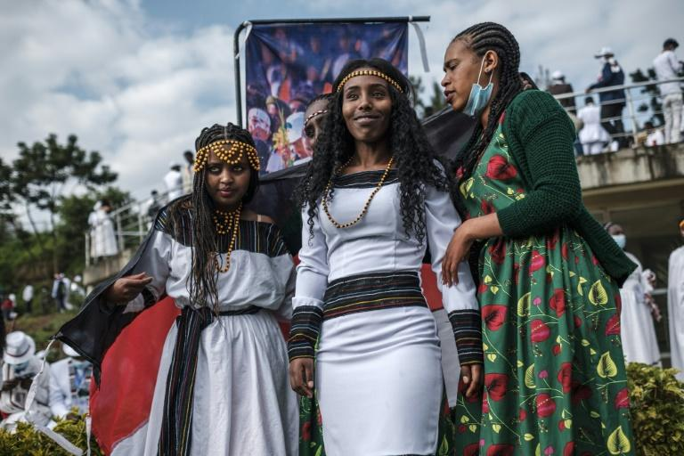 """People in traditional clothing pose for pictures during the celebration of """"Irreechaa"""", the Oromo people thanksgiving holiday, in Addis Ababa, Ethiopia, on October 3, 2020.Members of Ethiopia's largest ethnic group gathered under heavy security in Addis Ababa for a scaled-back version of their annual thanksgiving festival against a backdrop of unrest and political division."""