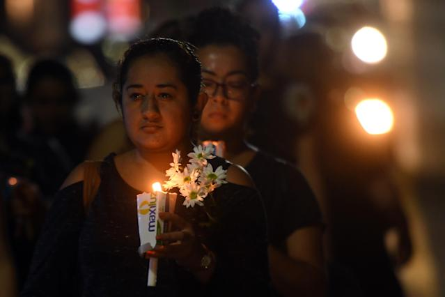 <p>Salvadoran women holding candles participate in a protest in commemoration of women murdered in El Salvador, as part of the celebration of International Women's Day in San Salvador on March 8, 2018. (Photo: Marvin Recinos/AFP/Getty Images) </p>