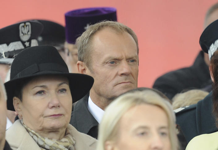 European Council President Donald Tusk, center, attends the official ceremony marking Poland's Independence Day, in Warsaw, Poland, Sunday, Nov. 11, 2018. Tusk joined celebrations in his native Poland on Independence Day, which celebrates the nation regaining its sovereignty at the end of World War I after being wiped off the map for more than a century. (AP Photo/Alik Keplicz)