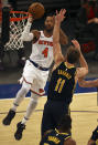 New York Knicks' Derrick Rose (4) heads for the net as Indiana Pacers' Domantas Sabonis (11) defends in the third quarter of an NBA basketball game Saturday, Feb. 27, 2021, in New York. (Elsa/Pool Photo via AP)