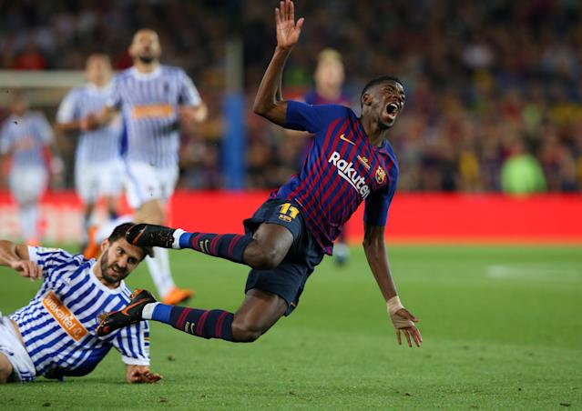 Soccer Football - La Liga Santander - FC Barcelona vs Real Sociedad - Camp Nou, Barcelona, Spain - May 20, 2018 Real Sociedad's Raul Navas in action with Barcelona's Ousmane Dembele REUTERS/Albert Gea