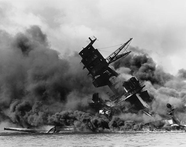 <p>The forward superstructure of the sunken battleship USS Arizona burns after the Japanese raid on Pearl Harbor on Dec. 7, 1941. (U.S. Navy/U.S. Naval History and Heritage Command/Handout via Reuters) </p>