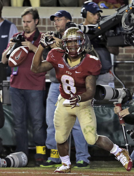 Florida State running back Devonta Freeman celebrates after scoring a touchdown against Miami during the third quarter of an NCAA college football game Saturday, Nov. 2, 2013, in Tallahassee, Fla. (AP Photo/Chris O'Meara)