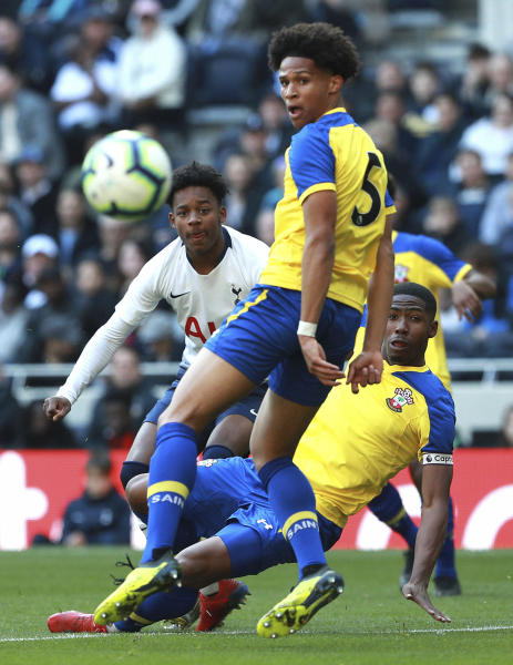 J'Neil Bennett, left, scores his side's first goal of the game against Southampton, during the U18 Premier League test event match at Tottenham Hotspur Stadium in London, Sunday March 24, 2019. Tottenham played Southampton in an Under-18 game in the first official test event at the newly opened 62,000-seater arena, and Spurs winger J'Neil Bennett scored the first-ever goal at the stadium on Sunday. (Ian Walton/PA via AP)