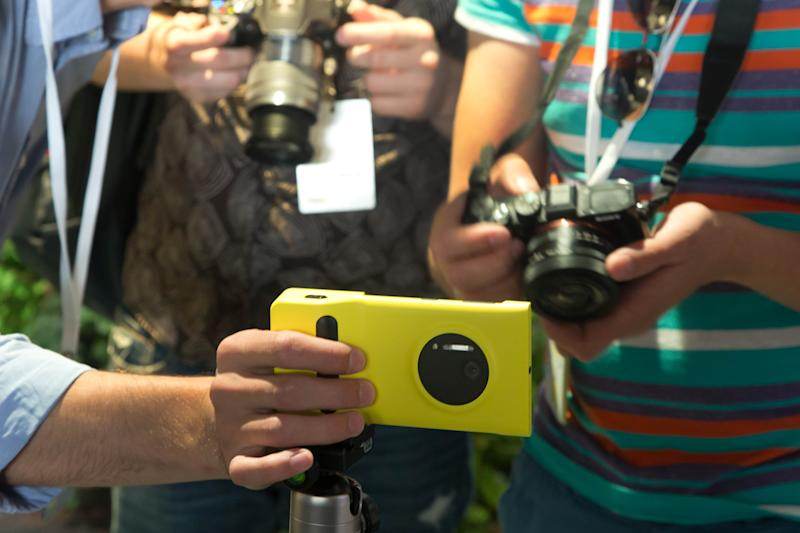 Journalists photograph a Lumia 1020 at its introduction, in New York, Thursday, July 11, 2013. The Nokia Lumia 1020, with a 41-megapixel camera, records more detail than other camera phones and even tops point-and-shoot cameras. (AP Photo/Richard Drew)