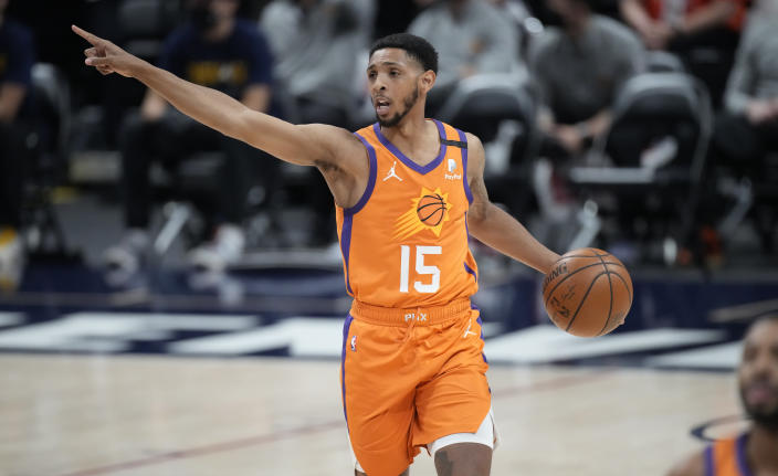 Phoenix Suns guard Cameron Payne directs teammates during the first half against the Denver Nuggets in Game 3 of an NBA second-round playoff series Friday, June 11, 2021, in Denver. (AP Photo/David Zalubowski)