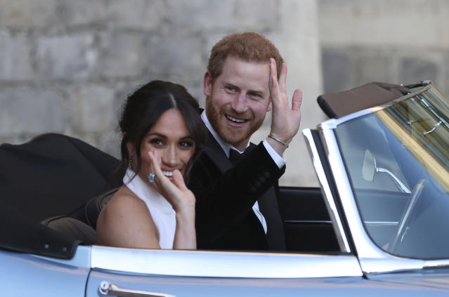 Meghan Markle and Prince Harry on their way to Frogmore House for their wedding reception. (Photo: Getty Images)
