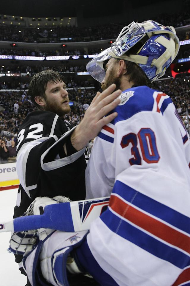 Los Angeles Kings goalie Jonathan Quick, left, greets New York Rangers goalie Henrik Lundqvist, of Sweden, right, after the Kings beat the Rangers in Game 5 of the NHL Stanley Cup Final series Friday, June 13, 2014, in Los Angeles. The Kings won, 3-2, in double overtime. (AP Photo/Jae C. Hong)