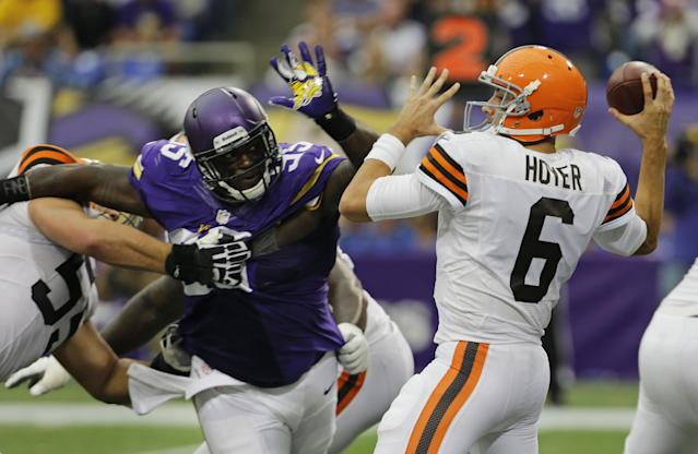 Cleveland Browns quarterback Brian Hoyer (6) passes the ball while getting pressured by Minnesota Vikings defensive tackle Sharrif Floyd during the second half of an NFL football game Sunday, Sept. 22, 2013, in Minneapolis. (AP Photo/Ann Heisenfelt)