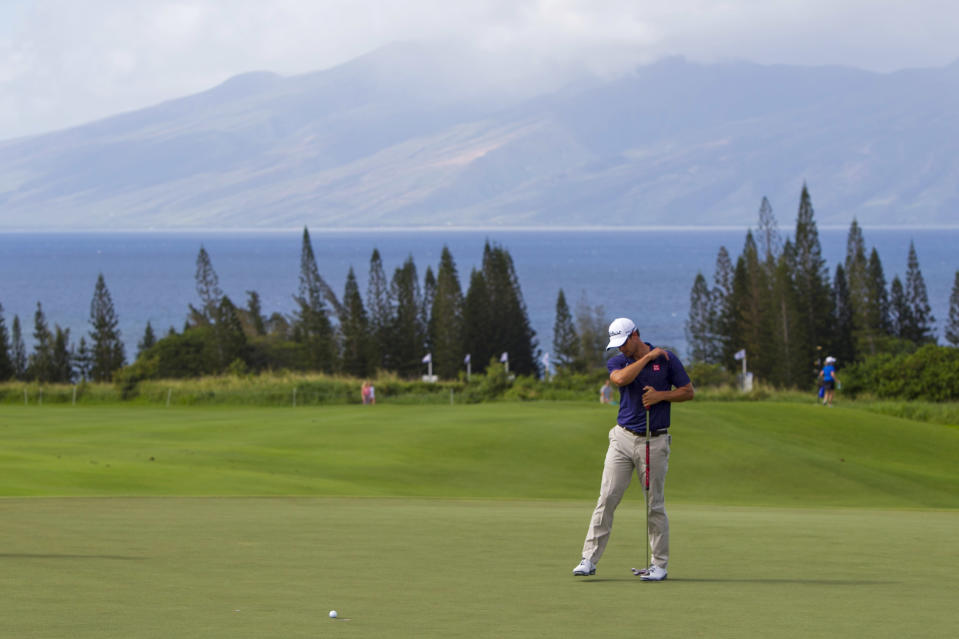 Adam Scott, of Australia, reacts to a missed birdie putt on the third green during the first round of the Tournament of Champions golf tournament, Friday, Jan. 3, 2014, in Kapalua, Hawaii. (AP Photo/Marco Garcia)