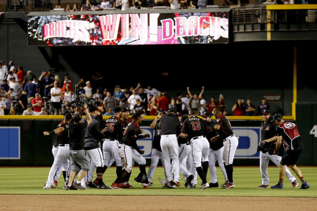 The Arizona Diamondbacks celebrate after defeating the Boston Red Sox in a baseball game, Saturday, April 6, 2019, in Phoenix. (AP Photo/Rick Scuteri)