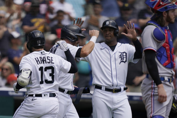 Detroit Tigers' Eric Haase (13), Robbie Grossman, center, and Jonathan Schoop celebrate after all scored on Haase's three-run home run to left field during the first inning of a baseball game against the Texas Rangers, Thursday, July 22, 2021, in Detroit. (AP Photo/Carlos Osorio)