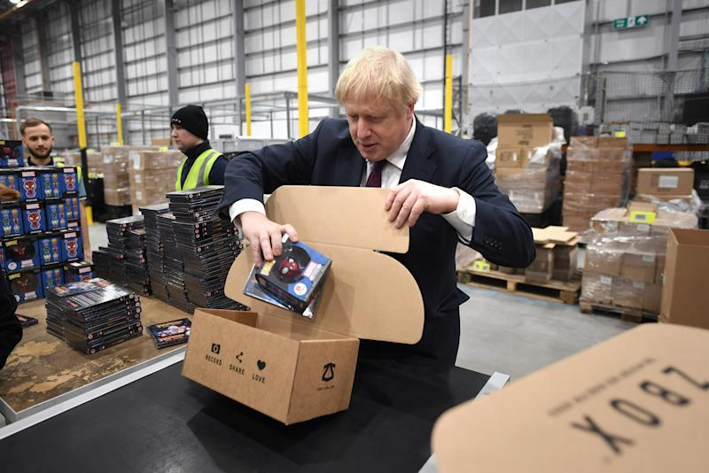 Prime Minister Boris Johnson during a visit to The Hut Group in Burtonwood, Warrington, while on the General Election campaign trail.
