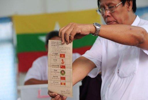 An election commision official shows a ballot paper during counting at a polling station at a Yangon constituency. Myanmar's opposition claimed a historic victory on Sunday for pro-democracy leader Aung San Suu Kyi in her first bid for a seat in parliament, sparking scenes of jubilation among supporters