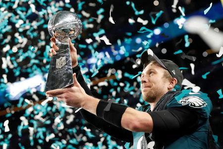 NFL Football - Philadelphia Eagles v New England Patriots - Super Bowl LII - U.S. Bank Stadium, Minneapolis, Minnesota, U.S. - February 4, 2018 Philadelphia Eagles' Nick Foles celebrates with the Vince Lombardi Trophy after winning Super Bowl LII REUTERS/Kevin Lamarque
