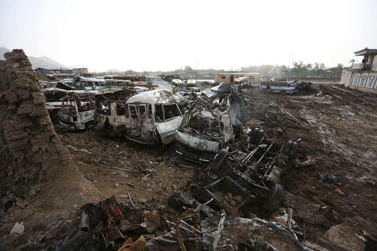 Destroyed cars are seen on the ground after yesterday's Taliban-claimed deadly suicide attack in Kabul, Afghanistan, Wednesday, April 20, 2016. The Afghan Interior Ministry says the death toll from Tuesday's Taliban attack in Kabul has risen sharply overnight. (AP Photo/Rahmat Gul)