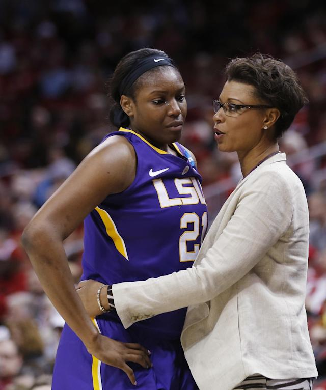 LSU head coach Nikki Caldwell embraces LSU forward Shanece McKinney (21) in the final moments of their 73-47 loss to Louisville in a regional semi final game at the NCAA college basketball tournament, Sunday, March 30, 2014, in Louisville, Ky. (AP Photo/John Bazemore)