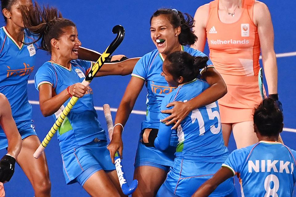 India's Rani (C) celebrates with teammates after scoring against Netherlands during their women's pool A match of the Tokyo 2020 Olympic Games field hockey competition, at the Oi Hockey Stadium in Tokyo on July 24, 2021.