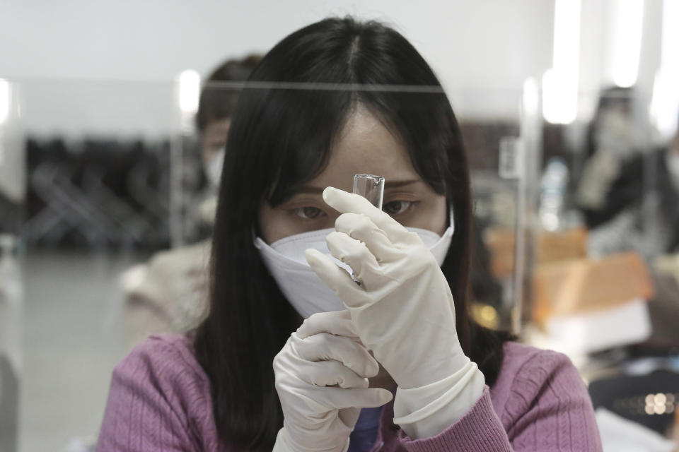 A medical worker attends a training session to learn how to give coronavirus vaccine shots at the Korean Nurses Association in Seoul, South Korea, Wednesday, Feb. 17, 2021. South Korea plans to start coronavirus inoculations on Feb. 26 with AstraZeneca's COVID-19 vaccine. (AP Photo/Ahn Young-joon)
