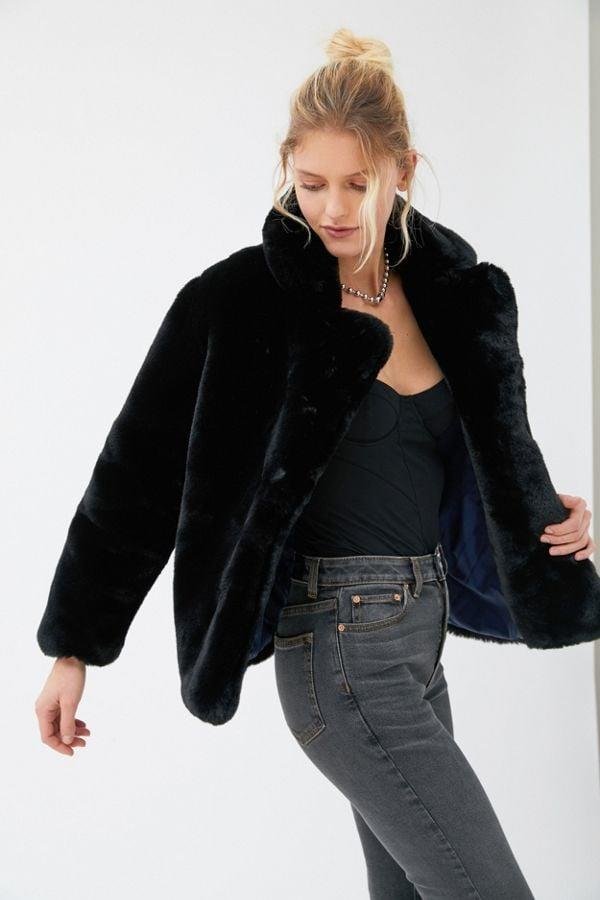 """<p>Go anywhere in this <a href=""""https://www.popsugar.com/buy/Apparis-Manon-Oversized-Faux-Fur-Coat-520477?p_name=Apparis%20Manon%20Oversized%20Faux%20Fur%20Coat&retailer=urbanoutfitters.com&pid=520477&price=285&evar1=fab%3Aus&evar9=43915942&evar98=https%3A%2F%2Fwww.popsugar.com%2Fphoto-gallery%2F43915942%2Fimage%2F46922586%2FApparis-Manon-Oversized-Faux-Fur-Coat&list1=shopping%2Cfall%20fashion%2Cfaux%20fur%2Ccoats%2Cfall%2Cjackets%2Cwinter%2Cwinter%20fashion&prop13=api&pdata=1"""" rel=""""nofollow"""" data-shoppable-link=""""1"""" target=""""_blank"""" class=""""ga-track"""" data-ga-category=""""Related"""" data-ga-label=""""https://www.urbanoutfitters.com/shop/apparis-manon-oversized-faux-fur-coat?category=SEARCHRESULTS&amp;color=001"""" data-ga-action=""""In-Line Links"""">Apparis Manon Oversized Faux Fur Coat</a> ($285).</p>"""