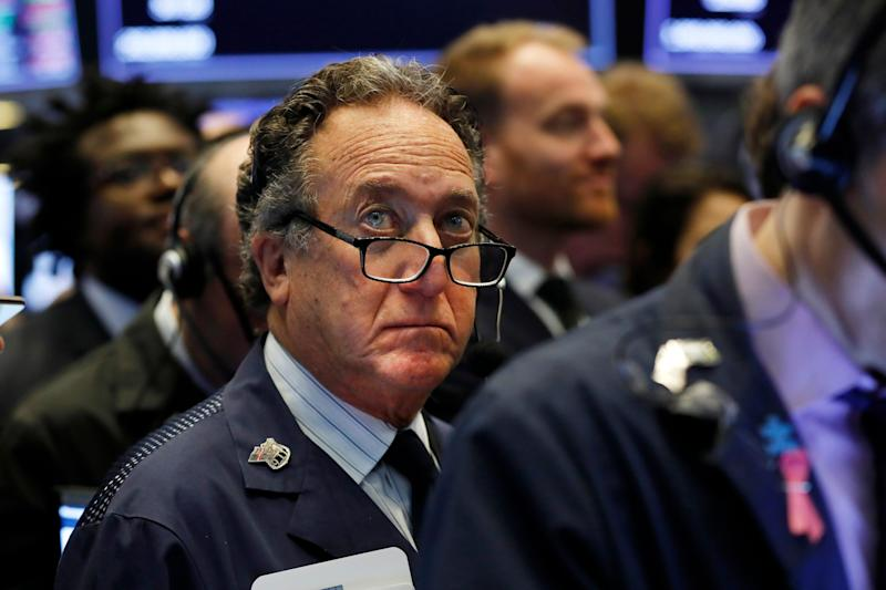 Trader Steven Kaplan works on the floor of the New York Stock Exchange, Friday, April 12, 2019. U.S. stocks moved broadly higher in early trading Friday on Wall Street, putting the market on track for gains at the end of a shaky week. (AP Photo/Richard Drew)