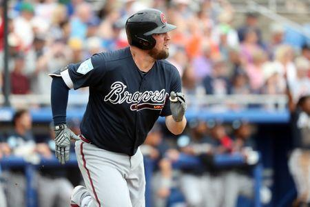 Mar 20, 2019; Dunedin, FL, USA; Atlanta Braves first baseman Andy Wilkins (96) hits a home run during the second inning against the Toronto Blue Jays at Dunedin Stadium. Mandatory Credit: Kim Klement-USA TODAY Sports