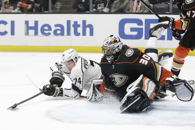 Los Angeles Kings' Nikolai Prokhorkin (74) tries to get the puck around Anaheim Ducks goaltender Ryan Miller (30) during the first period of an NHL hockey game Monday, Dec. 2, 2019, in Anaheim, Calif. (AP Photo/Marcio Jose Sanchez)