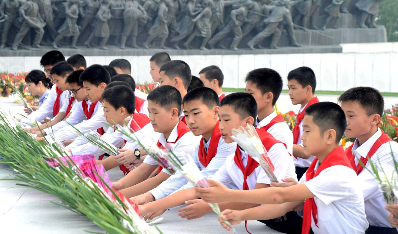 People lay flowers before the statues of President Kim Il Sung and leader Kim Jong Il on the 68th founding anniversary of the DPRK in this undated photo released by North Korea's Korean Central News Agency (KCNA) September 9, 2016. KCNA/via Reuters   ATTENTION EDITORS - THIS PICTURE WAS PROVIDED BY A THIRD PARTY. REUTERS IS UNABLE TO INDEPENDENTLY VERIFY THE AUTHENTICITY, CONTENT, LOCATION OR DATE OF THIS IMAGE. FOR EDITORIAL USE ONLY. NO THIRD PARTY SALES. SOUTH KOREA OUT. THIS PICTURE IS DISTRIBUTED EXACTLY AS RECEIVED BY REUTERS, AS A SERVICE TO CLIENTS.