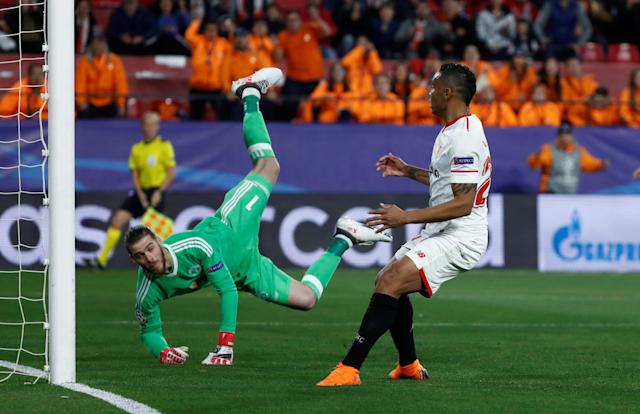 Soccer Football - Champions League Round of 16 First Leg - Sevilla vs Manchester United - Ramon Sanchez Pizjuan, Seville, Spain - February 21, 2018 Manchester United's David De Gea makes a save from Sevilla's Luis Muriel REUTERS/Juan Medina