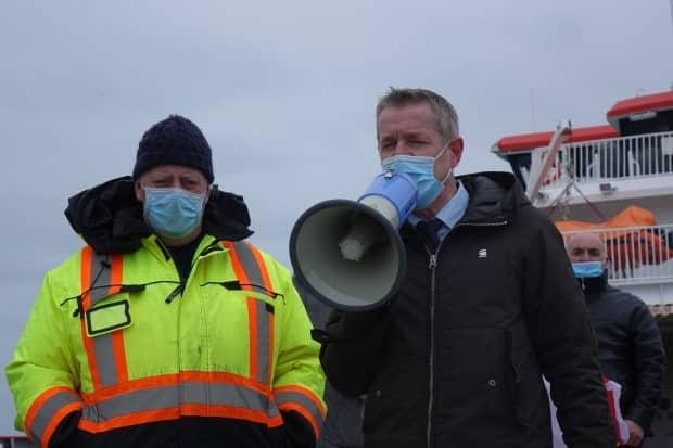 Territorial council president Bernard Briand, right, continued his lobbying efforts to restore the link between St-Pierre-Miquelon and Fortune. Border restrictions have severed ties — and left families stranded — between the two communities.