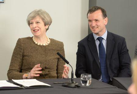 Britain's Prime Minister Theresa May and Welsh Secretary Alun Cairns attend a meeting at the Liberty Stadium in Swansea March 20, 2017. REUTERS/Ben Birchall/Pool