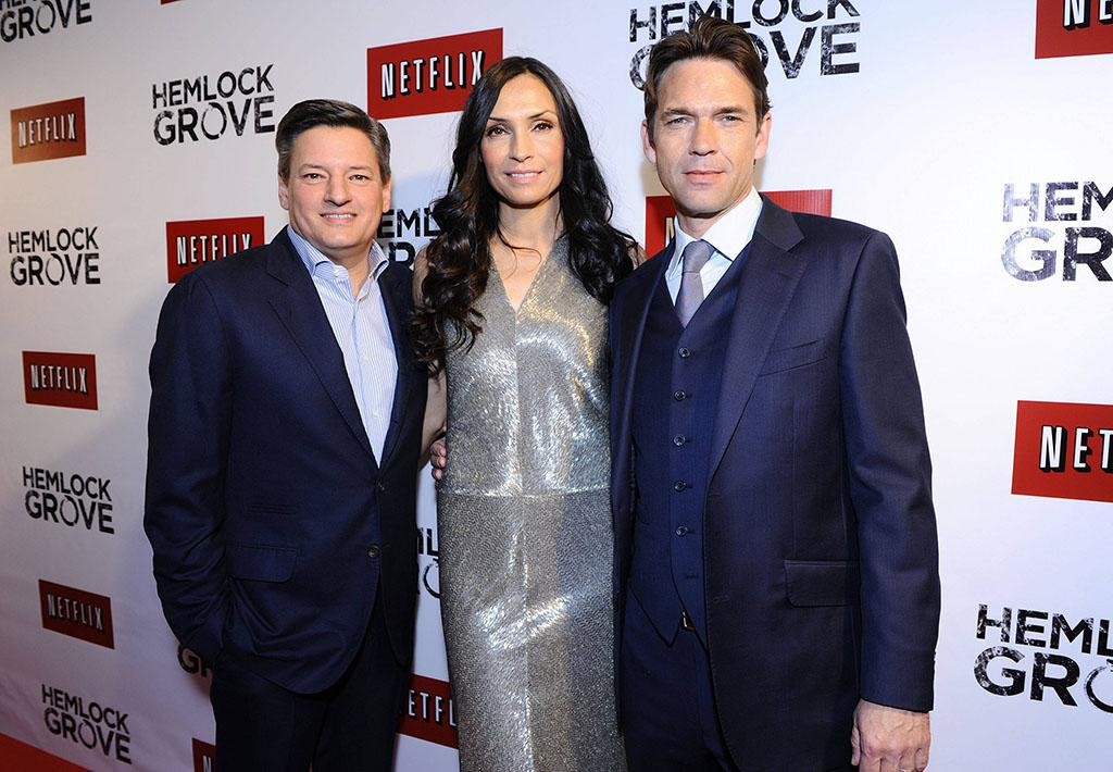 """Chief Content Officer at Netflix Ted Sarandos poses with actress Famke Janssen and actor Dougray Scott at the """"Hemlock Grove"""" North America premiere for Netflix on Tuesday April 16, 2013, in Toronto."""