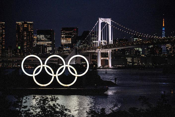 The Olympic rings lit up at dusk on the Odaiba waterfront in Tokyo on May 31, 2021.
