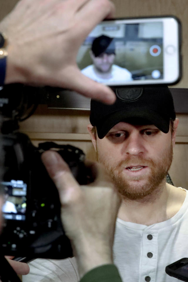 Pittsburgh Penguins' Phil Kessel talks with reporters in the practice facility locker room before leaving for the off season two days after being swept by the New York Islanders in the first round of the NHL hockey playoffs, Thursday, April 18, 2019, at their practice facility in Cranberry Township, Pa. (AP Photo/Keith Srakocic)