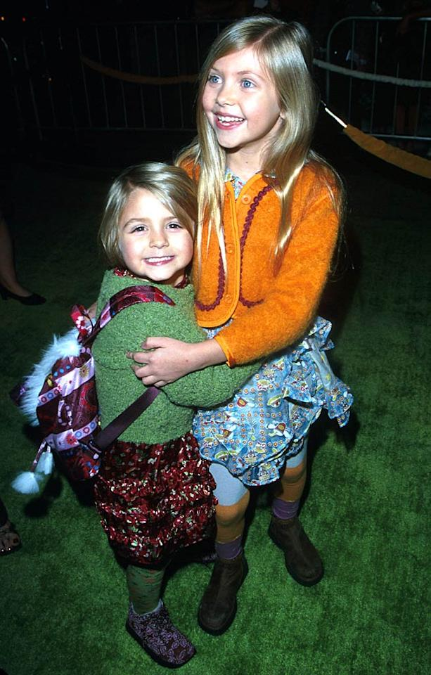 """November 2000: Who are those cuties? It's Taylor Momsen at age 7 (right) and her littler sister Sloan! The sisters rocked bright cardigans and tiered floral skirts for the premiere of Taylor's big screen debut in """"How the Grinch Stole Christmas.""""   <a href=""""http://www.seventeen.com/fashion/tips/best-dressed-moments-2010?link=rel&dom=yah_omg&src=syn&con=art&mag=svn"""" target=""""new"""">The Best Style Moments of 2010</a> Kathryn Indiek/<a href=""""http://www.wireimage.com"""" target=""""new"""">WireImage.com</a> - November 8, 2000"""
