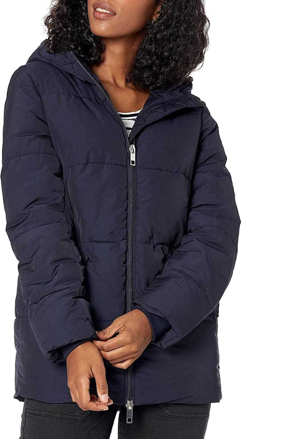 <p>This <span>Daily Ritual Primaloft Puffer Jacket</span> ($75) will protect you from the cold, yet it will not feel too heavy to wear. The color and silhouette make it extremely wearable.</p>