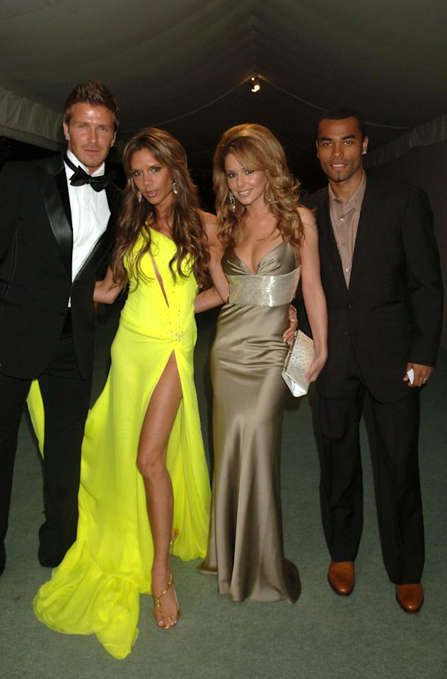 <p>Pulling out all the fashion stops, Victoria Beckham and the then-Cheryl Tweedy donned their finest clobber for the pre-World Cup 2006 party on 21 May. The former Spice Girls singer opted for a seriously flash-bearing neon dress while Cheryl upped the glamour factor with a slinky halterneck. <em>[Photo: Rex]</em> </p>