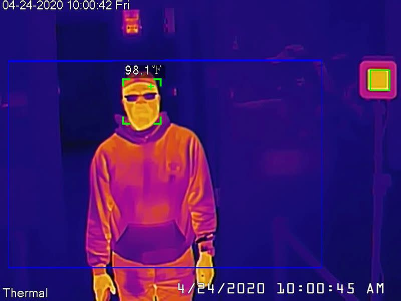Dahua thermal camera takes a man's temperature during a demonstration in San Francisco