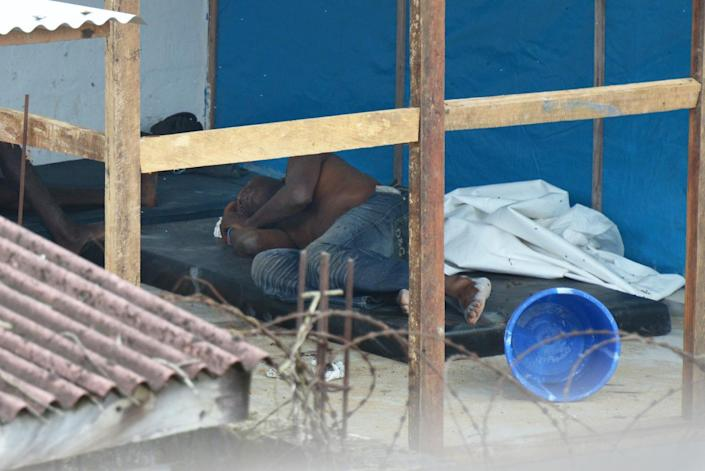 A man contaminated with Ebola rests on September 5, 2014 inside the high-risk area at the John Fitzgerald Kennedy hospital of Monrovia, Liberia (AFP Photo/Dominique Faget )
