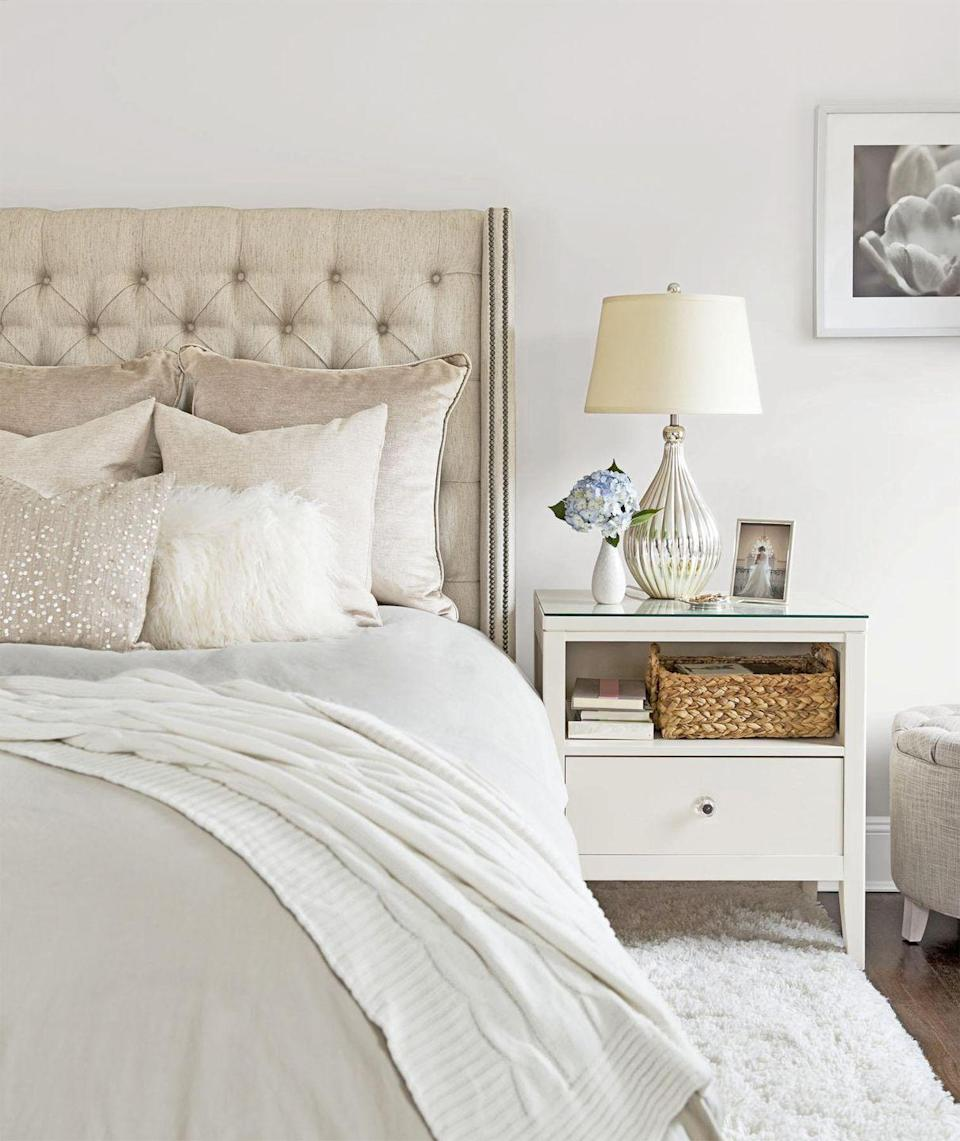 "<p>Give the items on your bedside table the <a href=""https://www.goodhousekeeping.com/home/organizing/a25846191/what-is-the-konmari-method/"" rel=""nofollow noopener"" target=""_blank"" data-ylk=""slk:Marie Kondo treatment"" class=""link rapid-noclick-resp"">Marie Kondo treatment</a> and pare down to the essentials, like a lamp, ring dish, basket for bedtime reading, and a sentimental piece, whether it's a favorite snapshot or passed-down trinket.</p><p><a href=""https://www.goodhousekeeping.com/home/organizing/g25848480/marie-kondo-storage-boxes/"" rel=""nofollow noopener"" target=""_blank"" data-ylk=""slk:RELATED: Where to Get Storage Boxes Like Marie Kondo's"" class=""link rapid-noclick-resp""><strong>RELATED:</strong> Where to Get Storage Boxes Like Marie Kondo's</a></p>"