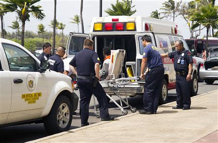 A 16-year-old boy is carried on a stretcher in Maui