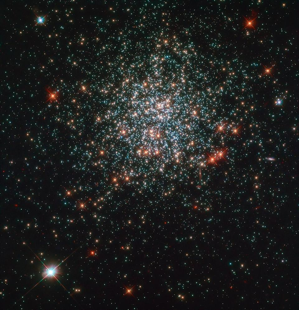 The star cluster NGC 2203 dazzles here in an image by the NASA/ESA Hubble Space Telescope. The cluster contains a number of interesting features including stars about twice as massive as our sun. In studying this cluster, astronomers hope to better understand the timeline and lives of stars.
