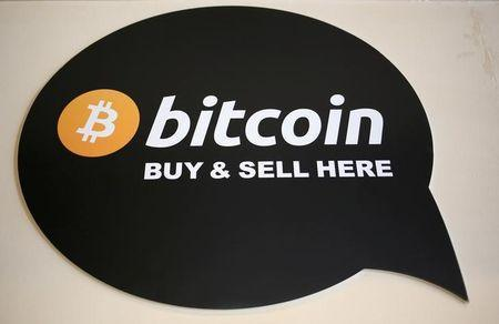 FILE PHOTO: A sign is seen in a restaurant where a Bitcoin ATM is located in Toronto, Ontario, Canada June 3, 2017. REUTERS/Chris Helgren/File Photo