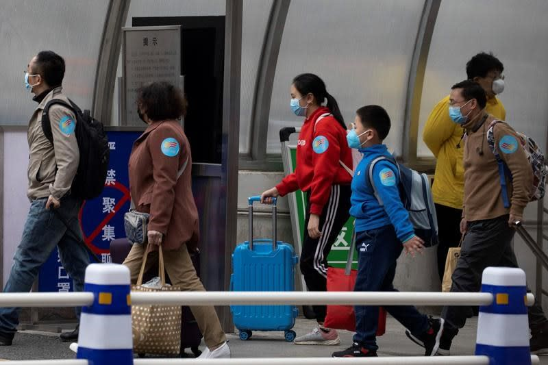 China bars most foreigners to curb imported virus cases