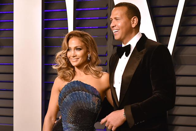 After two years of dating and endless adorable couple selfies, Alex Rodriguez and Jennifer Lopez are engaged. (Getty Images)