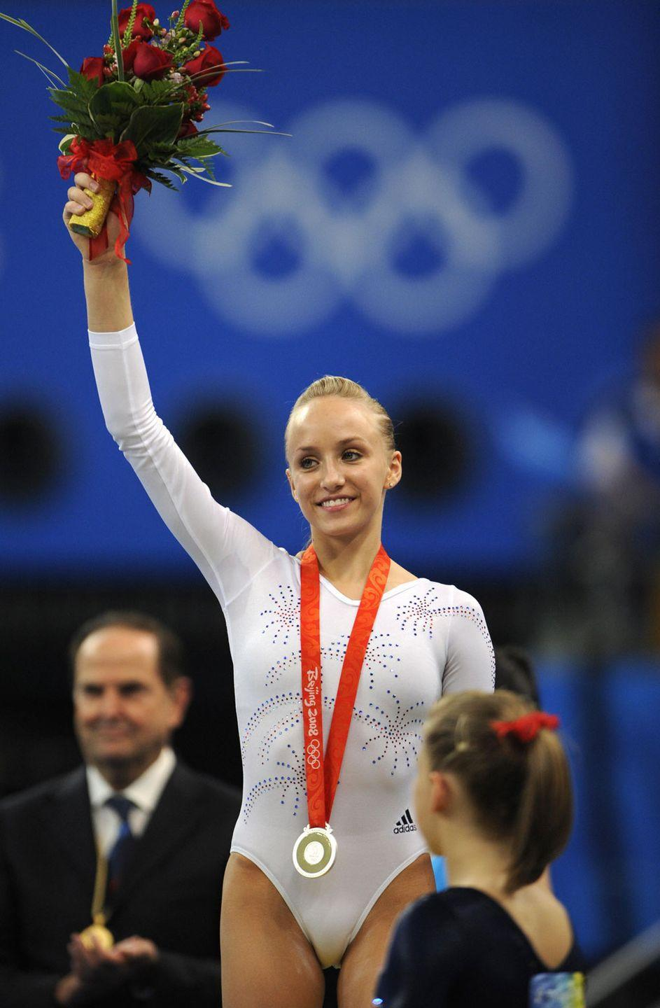 <p><em>Nastia Liukin</em><br></p><p>It's pretty much exactly the same as what Shawn Johnson wore that day but in white. Not that there is anything wrong with that. There are only so many ways to switch these things up.</p>