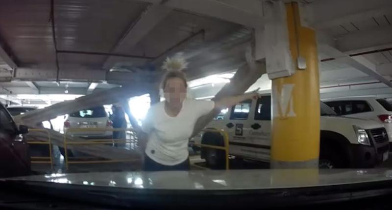 A woman was filmed on dash cam pointing and yelling at a man parking his car at Westfield Kotara on Saturday.
