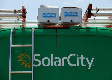 FILE PHOTO: A SolarCity vehicle is seen on the road in San Diego, California, U.S. June 22, 2016.        REUTERS/Mike Blake/File Photo