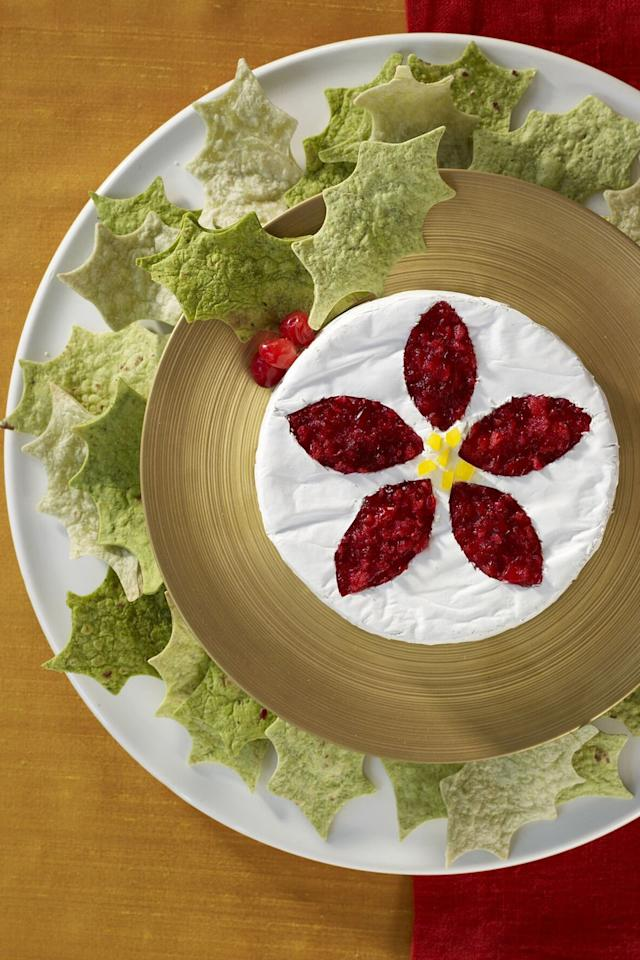 "<p>Wow your guests with this delicious holiday app featuring baked Brie topped with a spicy salsa made of cranberries, Granny Smith apple jalapeño, and fresh cilantro.</p><p><strong><a rel=""nofollow"" href=""https://www.womansday.com/food-recipes/food-drinks/recipes/a9357/tortilla-wreath-brie-recipe-121648/"">Get the recipe.</a></strong><a rel=""nofollow"" href=""https://www.womansday.com/food-recipes/food-drinks/recipes/a9357/tortilla-wreath-brie-recipe-121648/""></a></p><p><a rel=""nofollow"" href=""https://www.womansday.com/food-recipes/food-drinks/recipes/a9357/tortilla-wreath-brie-recipe-121648/""></a></p><p><a rel=""nofollow"" href=""https://www.womansday.com/food-recipes/food-drinks/recipes/a9357/tortilla-wreath-brie-recipe-121648/""></a></p><p><strong>What you'll need: </strong>AmazonBasics Nonstick Half Baking Sheet ($16, <a rel=""nofollow"" href=""https://www.amazon.com/dp/B00XBC3T6Q""></a><a rel=""nofollow"" href=""https://www.amazon.com/AmazonBasics-Nonstick-Carbon-Steel-Baking/dp/B073P51XSY/"">amazon.com</a>)<br></p>"